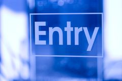 Blue Entry. Sign on glass Royalty Free Stock Photography