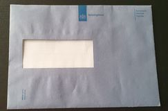 Blue envelop of the Belastingdienst, the dutch tax organization. With most of the times a payment letter in to it royalty free stock image