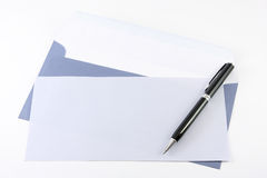 Blue envelop and pen Royalty Free Stock Photography