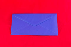 Blue envelope on red background Royalty Free Stock Photo