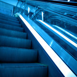 Blue escalator Stock Photography