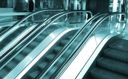 Blue escalators Royalty Free Stock Photography