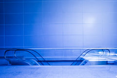 Blue escalators in corridor royalty free stock photography