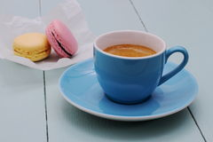 Blue Espresso Cup and two macarons biscuit Royalty Free Stock Photo