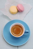 Blue Espresso Cup and two macarons biscuit Stock Image