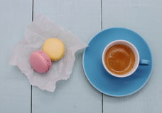 Blue Espresso Cup and two macarons Stock Photo