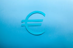 Blue euro icon. Blue euro symbol on a blue background with a soft light Stock Photography