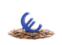 Blue euro symbol with pile of coins. Blue euro symbol with pile of golden coins royalty free stock images