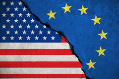 Blue european union EU flag on broken wall and half usa united states of america flag, crisis trump president and europe euro. Concept stock image