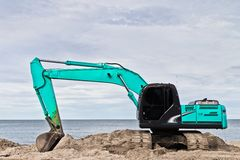 Blue excavators are working. Royalty Free Stock Image