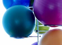 Blue Exercising Ball on Stainless Steel Exercising Ball Rack Stock Images