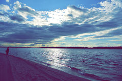 Blue expanse of water and amazing sky Royalty Free Stock Images