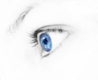 Blue eye. Photo of a young girl blue eye Royalty Free Stock Photo