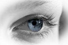 Blue Eye. A macro of an eye desaturated of color except for the blue iris Royalty Free Stock Photography