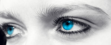 Blue eye. S of a young woman in black and white Stock Photos