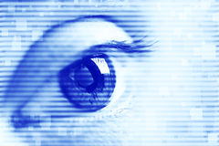 Blue eye. Close up of blue eye with blue techno lines and squares royalty free stock photography