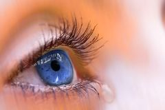 Blue eye. A macro view of a tearful blue eye Royalty Free Stock Photography