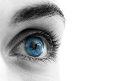 Blue eye. Female Blue eyes (partially desaturated in PS Royalty Free Stock Photo