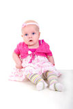 Blue Eye Baby Girl In Purple. Stock Photos