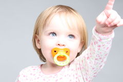 Blue eye baby pointing up Royalty Free Stock Photo