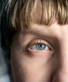 Blue eye of the boy close up macro Royalty Free Stock Image
