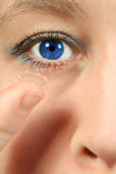 Blue eye contact lens Stock Images