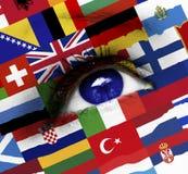 Blue eye with european flags. Closeup of blue eye with european flags royalty free stock photography