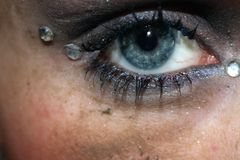 Blue eye with gems and dirty face Stock Images