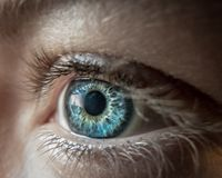Blue eye lense stock photo