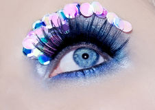 Blue eye macro closeup makeup sequins colorful. Fashion detail Royalty Free Stock Image