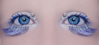 Blue eye macro closeup winter makeup Royalty Free Stock Photography
