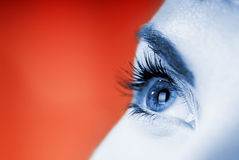 Blue eye on red background Royalty Free Stock Photo