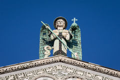 Blue Eyed Angel Atop an Ornate Church Facade Stock Photography