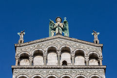 Blue Eyed Angel Atop an Ornate Church Facade Royalty Free Stock Image