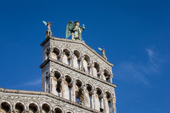 Blue Eyed Angel Atop an Ornate Church Facade Stock Image