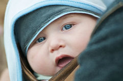 Blue-eyed baby Stock Images