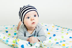 The blue-eyed baby. Funny cute blue-eyed baby. Little boy astonished royalty free stock photo