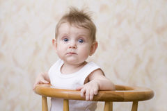 Blue Eyed Baby On High Chair Royalty Free Stock Photo