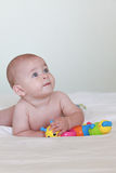 Blue eyed baby looking up, naked Royalty Free Stock Photos