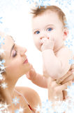 Blue-eyed baby in mother hands Royalty Free Stock Images