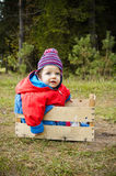 Blue-eyed baby outdoors, autumn season.8months old Royalty Free Stock Image