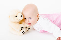 Blue-eyed baby with a soft toy. studio photo Royalty Free Stock Photos