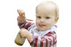 Blue eyed blond baby eating apple sauce Stock Photography