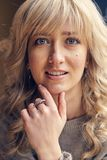 Portrait of beautiful blond woman. Blue eyed blond beauty smiling to camera Royalty Free Stock Images