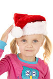 Blue eyed blond girl touching her santa hat Stock Images