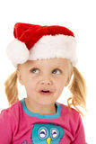 Blue eyed blond girl wearing santa hat looking up Royalty Free Stock Photography