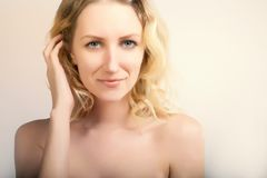 Blue eyed blond model posing on white backgrpund,beauty and fas Stock Photos