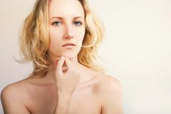 Blue eyed blond model posing on white backgrpund,beauty and fas Royalty Free Stock Images