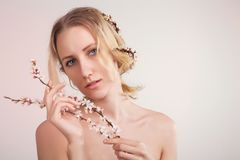 Blue eyed blond model posing on white backgrpund,beauty and fas Stock Photography