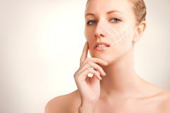 Blue eyed blonde model portrait with skin surgery mark isolated Stock Photo